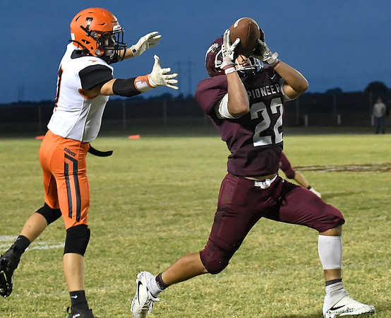 Pioneer's Rafael Torres intercepts a pass in front of Yale's P.J. Reese Friday, September 20, 2019 at Pioneer High School. (Billy Hefton / Enid News & Eagle)