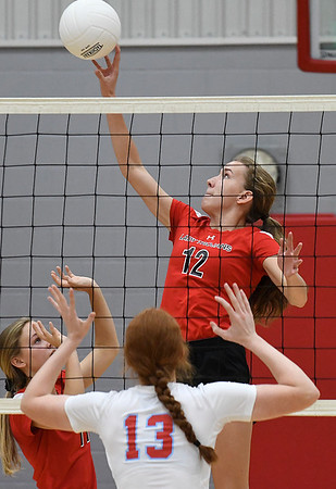 OBA's Reese Westrope hits the ball over Chisholm's Lydia Peace Monday September 9, 2019 at Chisholm Middle School. (Billy Hefton / Enid News & Eagle)