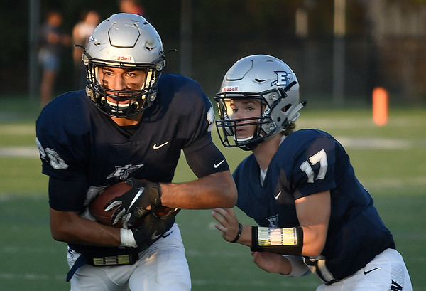 Enid's Johnny Villa takes a handoff from Maddax Mayberry against Ponca City Friday, September 6, 2019 at D. Bruce Selby Stadium. (Billy Hefton / Enid News & Eagle)