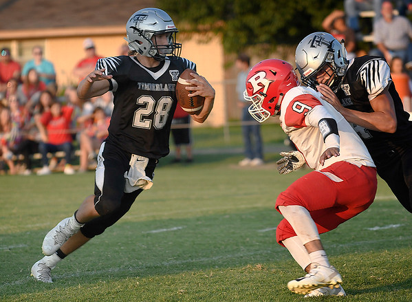Timberlake's Devon Kent carries the ball as J.J. Pippin blocks Ringwood's Easton Crawford Thursday, September 5, 2019 at Timberlake High School. (Billy Hefton / Enid News & Eagle)