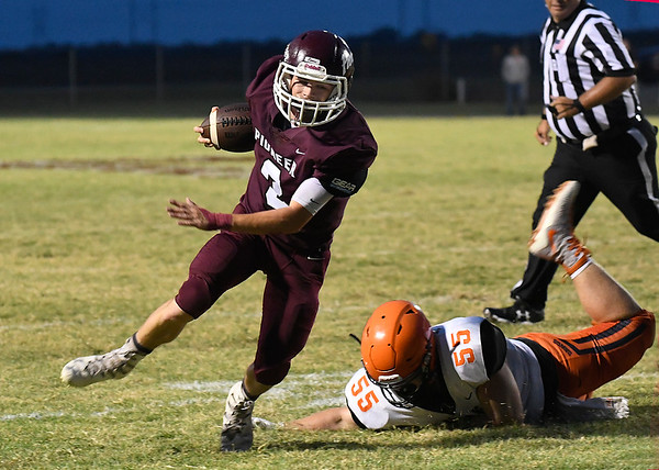 Pioneer's Ty Dennett gets away from Yale's Trinton Hiltman Friday, September 20, 2019 at Pioneer High School. (Billy Hefton / Enid News & Eagle)