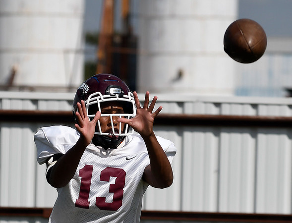 Pioneer's Marzel Washington catches a pass during practice Wednesday, September 11, 2019 at Pioneer High School. (Billy Hefton / Enid News & Eagle)