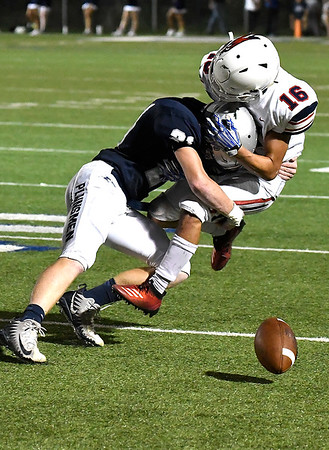 Enid'sJonathan White knocks the ball losse from Ponca City's Sam McKinney Friday, September 6, 2019 at D. Bruce Selby Stadium. (Billy Hefton / Enid News & Eagle)
