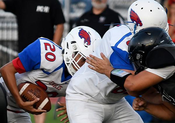 Deer Creek-Lamont'sPalladin Compala follows Cade Light on a quarterback sneak against Pond Creek-Hunter Thursday, September 19, 2019 at Panther Field in Pond Creek. (Billy Hefton / Enid News & Eagle)