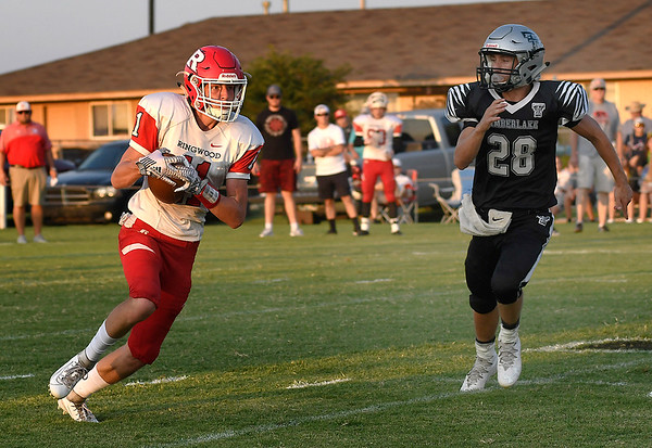 Ringwood's Jacob Briggs tries to run pass Timberlake's Devon Kent after making a catch Thursday, September 5, 2019 at Timberlake High School. (Billy Hefton / Enid News & Eagle)