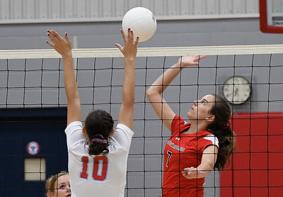 OBA's Emmie Lichty hits the ball against Chisholm's Raylee Savage Monday September 9, 2019 at Chisholm Middle School. (Billy Hefton / Enid News & Eagle)