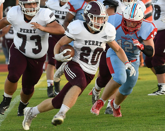 Perry's Kohl Witter carries the ball against Chisholm Friday, September 27, 2019 at Chisholm High School. (Billy Hefton / Enid News & Eagle)