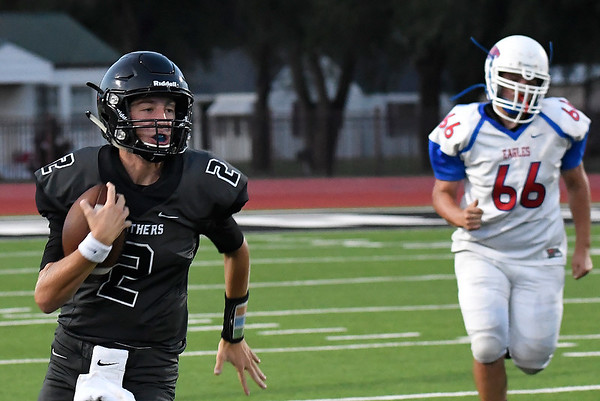 Pond Creek-Hunter's Jake Ronck turns the corner against DCLA Thursday, September 19, 2019 at Panther Field in Pond Creek. (Billy Hefton / Enid News & Eagle)