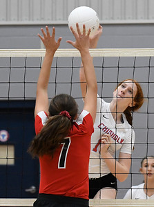 Chisholm's Lydia Peace hits the ball against OBA's Emmie Lichty Monday September 9, 2019 at Chisholm Middle School. (Billy Hefton / Enid News & Eagle)