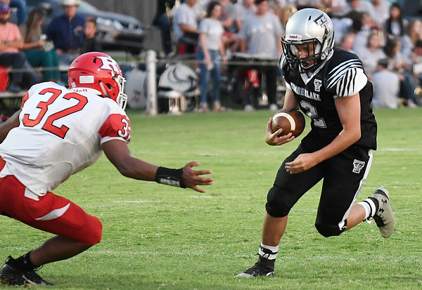 Timberlake's Ethan Jenlink carries the ball against Ringwood's Angel Charqueno Thursday, September 5, 2019 at Timberlake High School. (Billy Hefton / Enid News & Eagle)