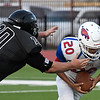 Pond Creek-Hunter's Kellen Claflin sacks DCLA's Palladin Compala Thursday, September 19, 2019 at Panther Field in Pond Creek. (Billy Hefton / Enid News & Eagle)