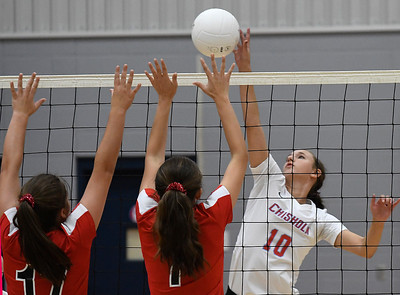 Chisholm's Raylee Savage tries to get the ball pass OBA's Emmie Lichty and Sydeny Winter Monday September 9, 2019 at Chisholm Middle School. (Billy Hefton / Enid News & Eagle)
