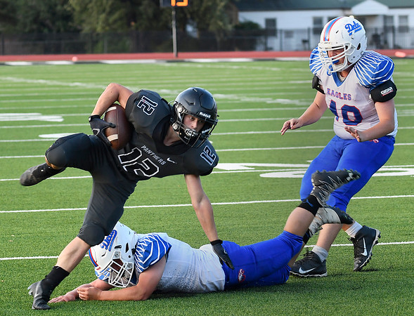Pond Creek-Hunter's Connor Czapansky maintains his balance while avoiding a tackle attempt from DCLA's Laker Ingram Thursday, September 2, 2021 at Pond Creek-Hunter High School. (Billy Hefton / Enid News & Eagle)