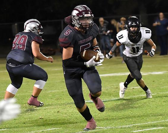 Garber's Carson Schovanec runs after making a catch against Pond Creek-Hunter Friday, September 24, 2021 at Garber High School. (Billy Hefton / Enid News & Eagle)