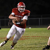 Ringwood's Cody Connaway clutches the ball as he runs against Covington-Douglas Friday, September 10, 2021 at Ringwood High School. (Billy Hefton / Enid News & Eagle)