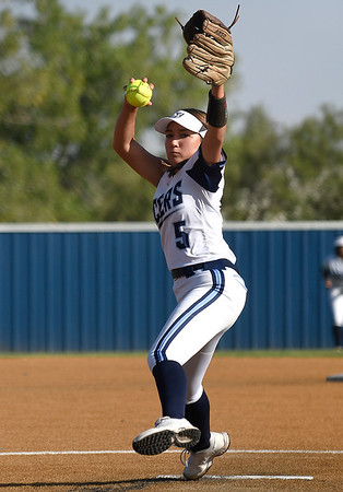 Enid's Mady Withey delivers a pitch against Stillwater Monday, September 20, 2021 at Pacer Field. (Billy Hefton / Enid News & Eagle)