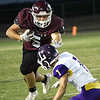 Pioneer's Caden Humphries carries the ball against Laverne's Carson Lovell Thursday, September 23, 2021 at Pioneer High School. (Billy Hefton / Enid News & Eagle)