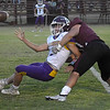 Laverne's Peyton Freeman gets a pass off while being taken down by Pioneer's Robert Newberg Thursday, September 23, 2021 at Pioneer High School. (Billy Hefton / Enid News & Eagle)