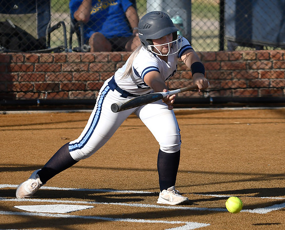 Enid's Chloee Robinson lays downa sacrifice bunt against Stillwater Monday, September 20, 2021 at Pacer Field. (Billy Hefton / Enid News & Eagle)