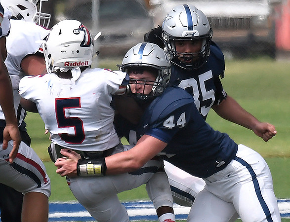 Enid's Brittan Combs stops Ponca City's Cameron Jackson Saturday, September 4, 2021 at D. Bruce Selby Stadium. (Billy Hefton / Enid News & Eagle)