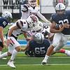Enid's Luke Rauh runs the ball against Ponca City's Grant Harmon Saturday, September 4, 2021 at D. Bruce Selby Stadium. (Billy Hefton / Enid News & Eagle)
