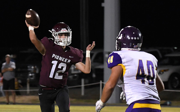 Pioneer's Ty Parker throws a pass against Laverne Thursday, September 23, 2021 at Pioneer High School. (Billy Hefton / Enid News & Eagle)