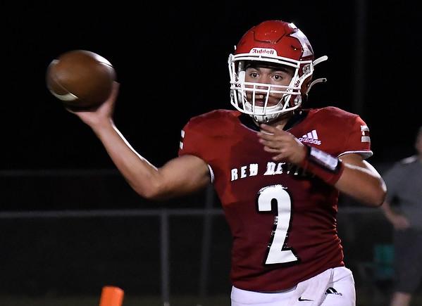 Ringwood's Jaxon Meyer throws a pass against Covington-Douglas Friday, September 10, 2021 at Ringwood High School. (Billy Hefton / Enid News & Eagle)