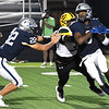 Enid's Tykie Andrews carries the ball as Luke Rauh tries to block MacArthur's Devin Bush Friday, September 17, 2021 at D. Bruce Selby Stadium. (Billy Hefton / Enid News & Eagle)