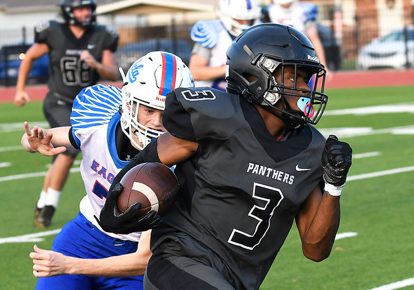 Pond Creek-Hunter's Harrison Stapleton out runs DCLA's Cutler Smith for a 65 yard pass reception for a touchdown on the first play of the game Thursday, September 2, 2021 at Pond Creek-Hunter High School. (Billy Hefton / Enid News & Eagle)