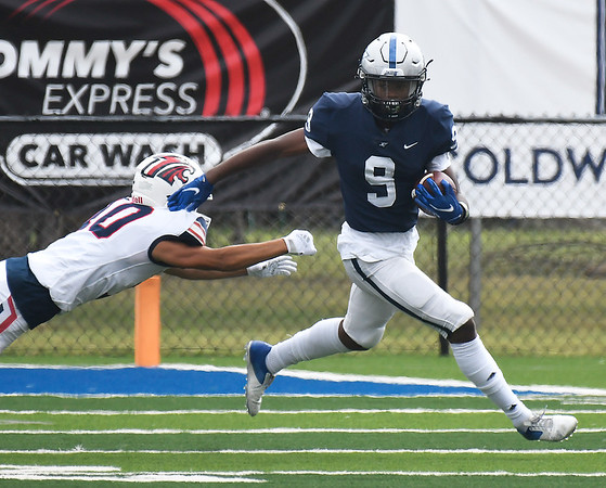 Enid's Tykie Andrews gets away from Ponca City's Bryce Shoptese Saturday, September 4, 2021 at D. Bruce Selby Stadium. (Billy Hefton / Enid News & Eagle)