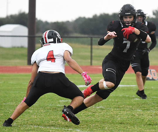 OBA's Bodie Boydstun looks to get away from Life Prep's Gonzalo Armas Friday, September 3, 2021 at Oklahoma Bible Academy. (Billy Hefon / Enid News & Eagle)