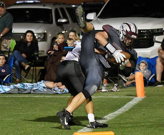 Garber's David Nagel gets a foot down for a touchdown against against Pond Creek-Hunter's Ashton Banks Friday, September 24, 2021 at Garber High School. (Billy Hefton / Enid News & Eagle)