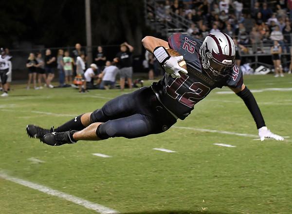 Garber's David Nagel is upended after making a catch against Pond Creek-Hunter Friday, September 24, 2021 at Garber High School. (Billy Hefton / Enid News & Eagle)