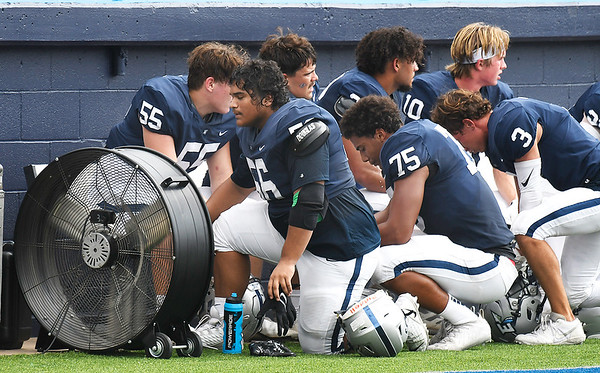 Enid defensive plays take advantage of a fan on the sideline against Ponca City Saturday, September 4, 2021 at D. Bruce Selby Stadium. (Billy Hefton / Enid News & Eagle)