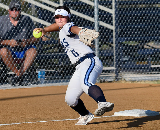 Enid's Chloee Robinson makes a throw to first against Stillwater Monday, September 20, 2021 at Pacer Field. (Billy Hefton / Enid News & Eagle)