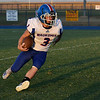 Waukomis's Ricky Woodruff carries the ball against Covington-Douglas Friday, September 24, 2021 at Covington-Douglas High School. (Billy Hefton / Enid News & Eagle)