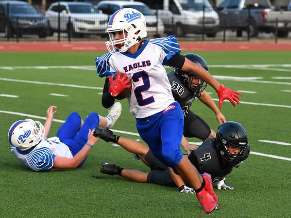 DCLA's ben Lowery carries the ball against Pond Creek-Hunter Thursday, September 2, 2021 at Pond Creek-Hunter High School. (Billy Hefton / Enid News & Eagle)