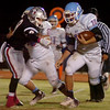 Okeene's Austin Jordan blocks OBA's Preston Atwood as Chance Bedwell races 20-yards for a Whippet touchdown at Commitment Field Friday, Oct. 31, 2014. (Staff Photo by BONNIE VCULEK)