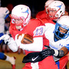 Chisholm's Luke Ball escapes a tackle by Millwood's D'Andre Mays during the first round of the football playoffs at Longhorn Field Friday, Nov. 14, 2014. (Staff Photo by BONNIE VCULEK)