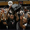Tavares Sledge holds up the championship trophy following the Outlaws 120-107 win over Syracuse to claim the TBL title Saturday, July 24, 2021 at the Stride Bank Center. (Billy Hefton / Enid News & Eagle)