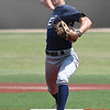 Enid Plainsmen's Seth Carlson delivers a pitch against Walkon 18U during the Big Fire Tournament Friday, July 23, 2021. (Billy Hefton / Enid News & Eagle)