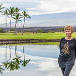 Anita at our Resort with Mauna Kea in the Background