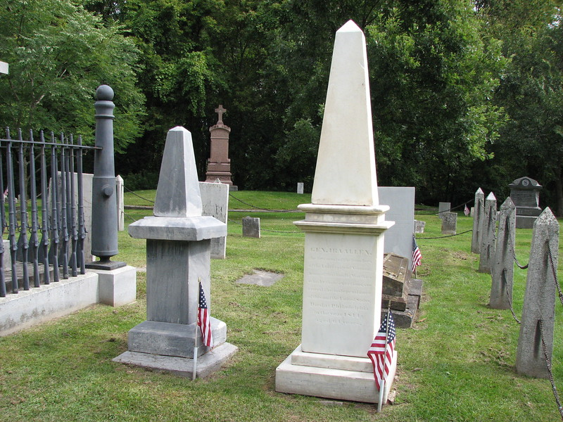 The gray obelisk is Heman Allen's. The white one is his brother Ira's. Their brother Ethan's column is within the enclosure seen to the left.