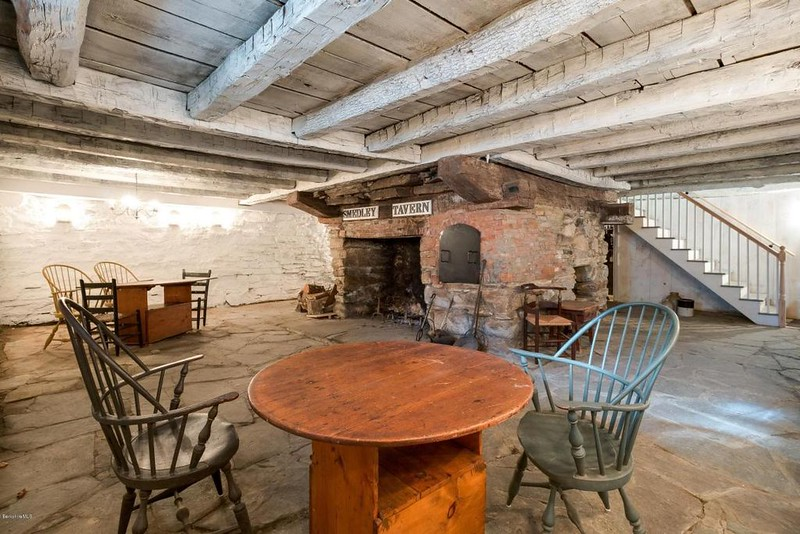 Basement of the house, said to be the area used as the tavern. An article in Yankee Magazine Jan-Feb 2017 states that Arnold slept in a room behind the chimney.