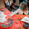 Savannah Morehouse, 4, of Manchester picks out some pretty gems for her artwork in the International Station of the Enterprise Bank Holiday Event in Lowell. SUN/Caley McGuane