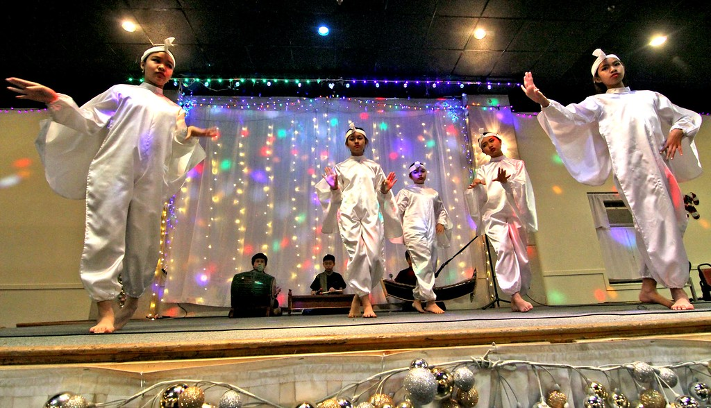 . Afro-Latin percussion and dancers from the Lowell Community Charter Public School perform at the Enterprise Bank 4th annual International Holiday party. SUN/ David H. Brow