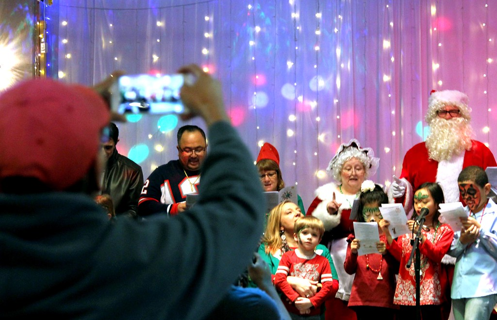 """. The grand finale \""""Holiday Karaoke\"""" for the Enterprise Bank 4th annual International Holiday Celebration. SUN/ David H. Brow"""