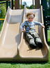 JACK LYNCH/THE ENTERPRISE<br /> 06.05.2015<br /> Aiden Finn 3 from Bourne takes a trip down the smaller slide at Mashpee Heritage park