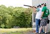 JACK LYNCH/ENTERPRISE<br /> 06.27.15<br /> Bob Joy Bernibha up from Burmingham Alabama sights in downrange on the elusive orange birds that tend to plauge the Falmouth Rod and Gun Club's trap and skeet ranges.