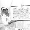 Mark Nicholas with Rory Bremner behind, presenting a signed group caricature of 40 top sport celebrities and cricketers at a charity cricket day at the HAC City of London 2000